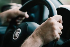 Close up of person learning how to hold the steering wheel at intensive driving school